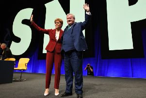 Nicola Sturgeon and Ian Blackford take the plaudits from delegates at the SNP conference (Picture: Jeff J Mitchell/Getty Images)