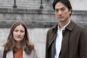 Kelly MacDonald and Takehiro Hira team up to solve a murder. Picture: BBC/Netflix