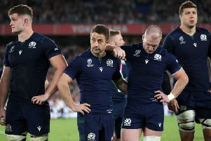 Dejection at the final whistle following defeat by Japan. But the numbers just don't stack up for Scotland. Picture: PA.