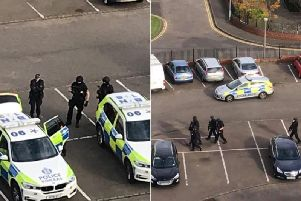 Armed police have been pictured in a car park in Moredun.