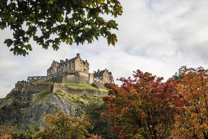 Who wouldn't want to live here? Edinburgh Castle is framed by trees displaying their autumn colours in Princes Street Gardens. (Picture: Jane Barlow/PA Wire)