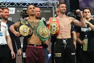 Regis Prograis, left, and Josh Taylor show off their respective world title belts during the weigh-in at Canary Wharf, London. Picture: TGS Photo/Shutterstock