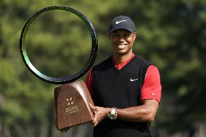 Tiger Woods shows off the trophy after his win in the Zoxo Championship in Japan. Picture: AP