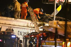 Rescue workers at the scene in November, 2013. Picture: Andrew Milligan/PA Wire.