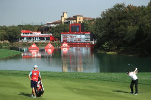 Bob MacIntyre hits his second shot at the 18th hole at Sheshan International en route to a two-under-par 70 in the first round of the WGC-HSBC Champions. Picture: Andrew Redington/Getty Images