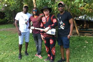 Lazarus Chigwandali, second from right, with Team Lazarus, from left, Esau Mwamwaya, Clem Kwizombwe and Spiwe Zulu, numbers Madonna among his fans