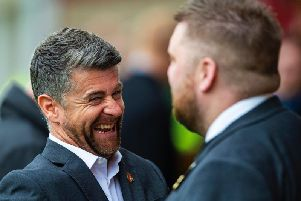 Motherwell boss Stephen Robinson chats with chief executive Alan Burrows before his side's game against Livingston. Picture: SNS
