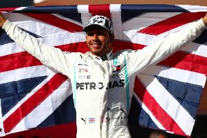 Lewis Hamilton celebrates after clinching his sixth world championship with a second-place finish at the Circuit of The Americas. Picture: Dan Istitene/Getty Images