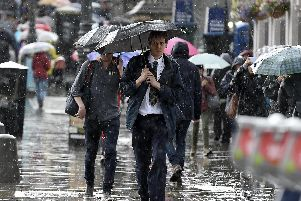 The Met Office has issued a yellow weather warning for rain in Scotland today, with certain areas set to see heavy downpours.