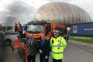 Transport secretary Michael Matheson, centre, with the world's first electric salt spreader at the Glasgow Science Centre today. Picture:The Scotsman