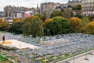 The Christmas market being built in Princes Street Gardens