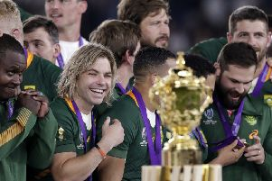 South Africa's Faf de Klerk, fourth left, smiles just before his team receives the Webb Ellis Cup. Picture: Aaron Favila/AP