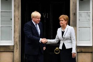 The first time Boris Johnson visited Scotland,he washeckled by protesters, forcing him to leave a meeting via the backdoor. Picture: Getty Images/ Jeff Mitchell