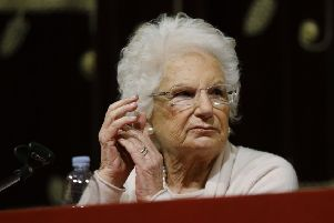 Holocaust survivor and Italian life senator Liliana Segre now has a permanent security escort after receiving hundreds of hate messages (Picture: Luca Bruno/AP)