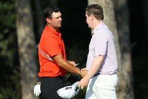 Playing partner Patrick Reed congratulates Bob MacIntyre on his round of 63 after the second day of the Turkish Airlines Open. Picture: Warren Little/Getty Images