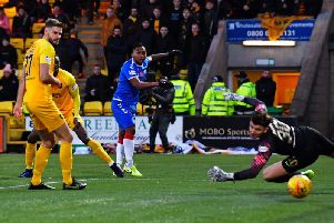 Alfredo Morelos squeezes his low shot into the far corner to secure the points for Rangers. Picture: SNS