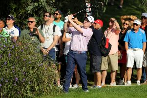 Bob MacIntyre plays his second shot on the thirteenth from behind a bush. Picture: Warren Little/Getty Images