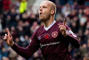 Steven Naismith celebrates after scoring Hearts' opener. Picture: SNS.