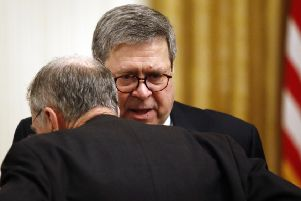 Attorney General William Barr, seen speaking to Democrat Chuck Schumer, refused to publicly clear Trump (Picture: Patrick Semansky/AP)