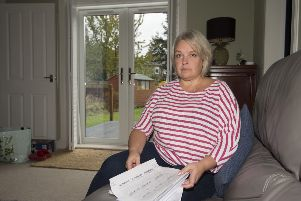 Mandy Atkins paid a �1,000 deposit for blinds but never received them. She won a court case but has still yet to see the money come back and has been struggling to stay afloat financially due to the problems'' Neil Hanna Photography'www.neilhannaphotography.co.uk'07702 246823