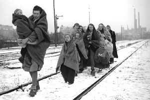 A handful of survivors from the 150 refugees who left Lodz in Poland two months earlier, headed for Berlin, arrive in the devastated German capital in December 1945. They are following railway lines on the outskirts of the city in the hope of being picked up by a British train. (Picture: Fred Ramage/Getty Images)