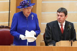 Presiding Officer Ken Macintosh listens intently as the Queen gives a speech to MSPsat the Scottish Parliament in during a ceremony marking the 20th anniversary of devolution in June this year. Picture: Getty