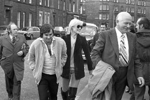 George Best and wife Angie with Hibs chairman Tom Hart at Easter Road in November 1979.