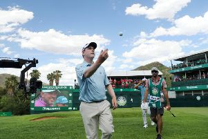 Bob MacIntyre throws his ball into the crowd after carding a seven-under-par 65 in the third round of the Nedbank Challenge in Sun City. Picture: Getty Images