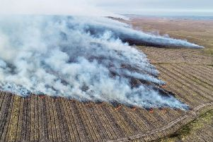 A wildfire burnt for almost six days on part of the Flow Country in the far north of Scotland in May this year. Picture: PA