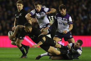 Finn Russell tackles Sonny Bill Williams during the last Autumn Test meeting between the two teams in November 2017