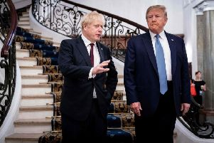 Donald Trump and Boris Johnson speak before a working breakfast at the August G7 Summit (Picture: Erin Schaff/AFP/Getty)