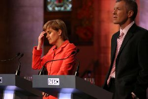 Nicola Sturgeon and Willie Rennie take part in a 2015 leaders' debate broadcast by the BBC. Picture: PA