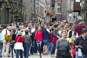 Tourists on Edinburgh's Royal Mile during the Festival (Picture: Ian Rutherford)