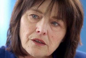 Jeane Freeman has apologised to parents affected by the water contamination scandal at QEUH.