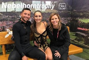 Lewis Gibson and Lilah Fear with a member of their coaching team, Josee Piche, at the Nebelhorn Trophy in Germany in September.
