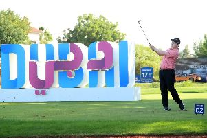 Bob MacIntyre hits hits third shot from the drop zone after finding water at the 17th in the second round of the DP World Tour Championship in Dubai. Picture: Getty Images