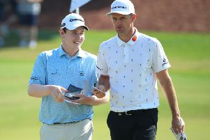 Bob MacIntyre and Justin Rose chat during the final round of the DP World Tour Championship Dubai at Jumerirah Golf Estates. Picture: Andrew Redington/Getty Images