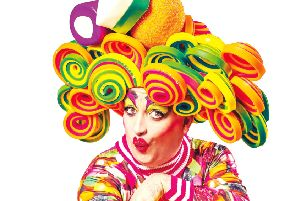 Johnny McKnight as Dame Dolly Mixture, owner of Stirling Stella hair salon