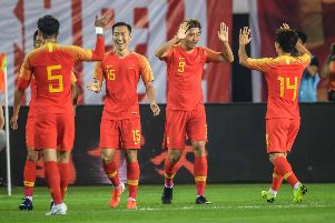 Chinese players (L-R) Zhang Linpeng (#5), Wu Xi, Yang Xu and Chi Zhongguo celebrate a goal during the World Cup 2022 qualifier football match between China and Guam in Guangzhou on October 10, 2019. (Photo by STR / AFP) / China OUT (Photo by STR/AFP via Getty Images)