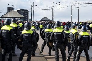 Dutch police in riot gear gather outside De Kuip stadium (File image)