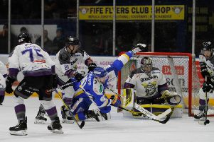 Tim Crowder takes a tumble against Manchester Storm last weekend.
