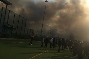 This photo, taken by one of the pupils, shows Peebles High School enveloped by thick smoke.