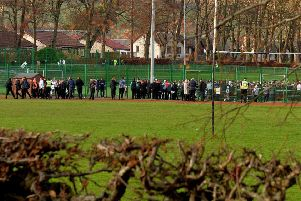 Evacuated pupils at the rear of the school.