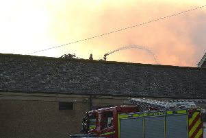 Firefighters attempt to extiguish the blaze in the old gym hall.