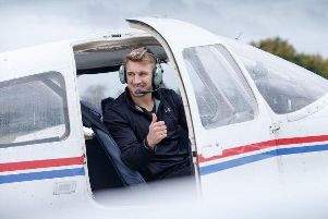 Scotland Sevens player and pilot Tom Brown gives the thumbs up ahead of take-off.