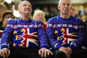 Brexit party supporters Barry Clarkson (R) and Alastair Sutcliffe proudly wearing their Brexit Christmas jumpers