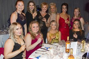 Natasha Gray, Molly Seed, Sally Jarvis, Caroline Tice, Sheryl Macauley, Ginny Stewart with, front, Jody Cree, Jessica Howlett, Mel Foggon and Becky Johnston at Saturday's ball in Kelso in memory of George Crawford.