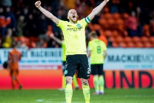 David Gray celebrates after Hibs won on their last trip to Tannadice. Picture: SNS