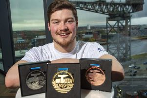Scott McLay with the official medals for Glasgow 2019, the LEN European short-course championships. Picture: Bill Murray/SNS
