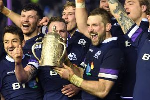 John Barclay, centre, and his Scotland team-mates celebrate with the Calcutta Cup. Picture: Gary Hutchison/SNS